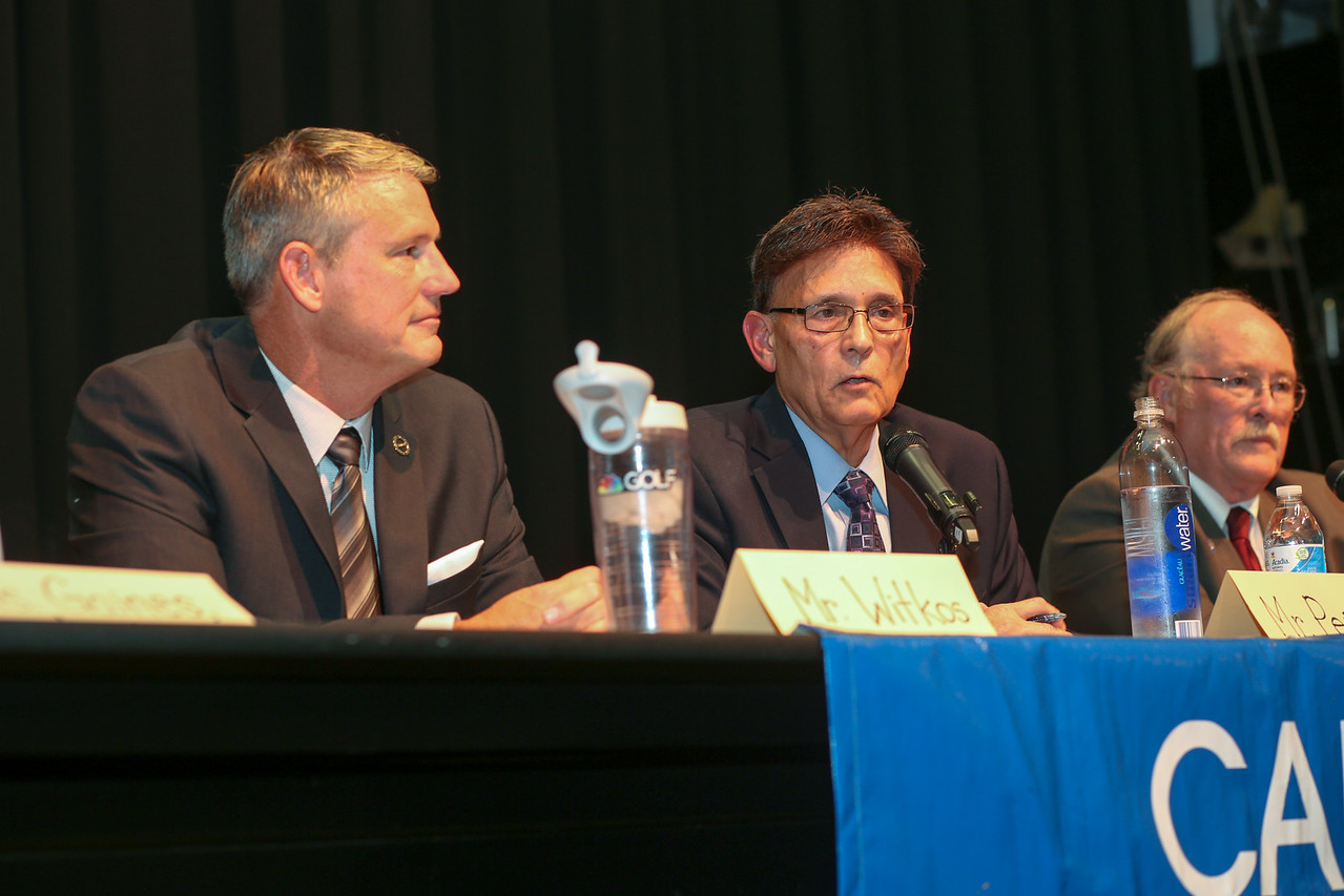 Avon Democrat David Peña (center) speaks at The Canton League of Women Voters Candidates' Forum on Oct. 18, 2016. He is challenging Canton Republican state Sen. Kevin Witkos, who is pictured at left. On the right is state Rep. Tim LeGeyt, who is running unopposed. <br /> Photo by John Fitts