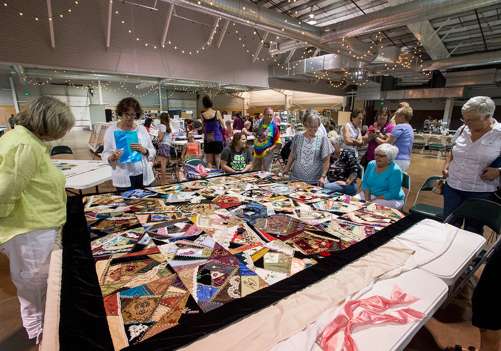 . Judges and spectators examine a quilt in the First National Bank Building Wednesday afternoon August 3, 2016 during the Larimer County Fair and Rodeo at The Ranch in Loveland. (Photo by Michael Brian/Loveland Reporter-Herald)