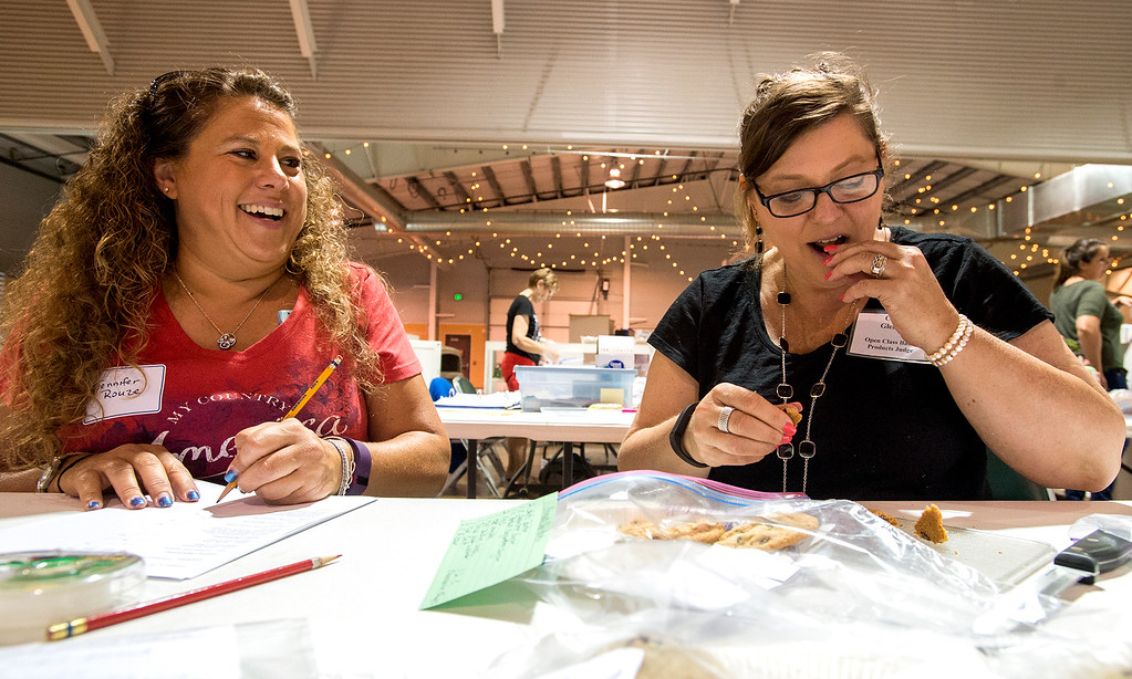 . Cindy Gleason, right, judges chocolate chip cookies Wednesday afternoon August 3, 2016 with assistance from Jennifer Rouze, left, in the First National Bank Building during the Larimer County Fair and Rodeo at The Ranch in Loveland. (Photo by Michael Brian/Loveland Reporter-Herald)