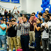 Football players cheer during the annual Thanksgiving pep rally at Leominster High on Tuesday morning. SENTINEL & ENTERPRISE / Ashley Green