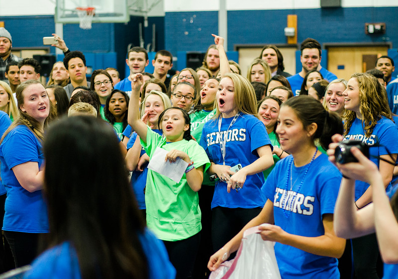 Students cheer as teachers get pied in the face during the annual Thanksgiving pep rally at Leominster High on Tuesday morning. SENTINEL & ENTERPRISE / Ashley Green