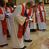 Fr. Heiner bows before the altar