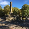 Opus 40 is a large environmental sculpture in Saugerties, New York, created by sculptor and quarryman Harvey Fite. It comprises a sprawling series of dry-stone ramps, pedestals and platforms covering 6.5 acres of a bluestone quarry.
