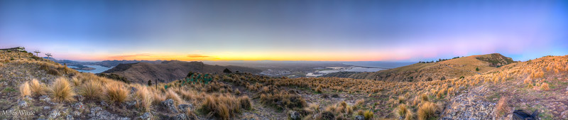 A bigger panorama of the beautiful sunset on the Mount Pleasant Scenic Reserve. Overlooking Christchurch. Christchurch is strait ahead. Off to the left is Quail Island and Lyttelton Harbour.