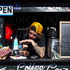 Carter Martinette servce coffee at the mobile Coffee Cartel during NuLu Holiday Open House.