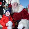 Noah Garris visits Santa at the NuLu Holiday Open House.