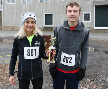 Women's winner Mary-Lynn Currier with her son Patrick Currier.  Photo by John Fitts