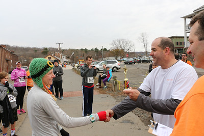 Colin O'Brien presents the women's second place trophy to Candice Casey.  Photo by John Fitts