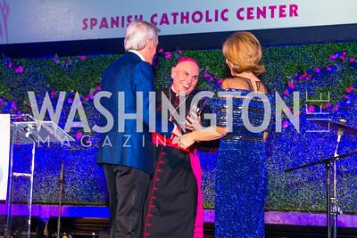 Enrique Segura, Bishop Mario Dorsonville, Alejandra Segura. Photo by Alfredo Flores. Catholic Charities Spanish Catholic Center Gala 2016. Ronald Reagan Building. October 28, 2016