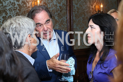"Michael Isikoff, Oliver Stone, Nora Maccoby Hathaway. Photo by Tony Powell. ""Snowden"" Screening After Party. Chez Billy Sud. September 7, 2016"