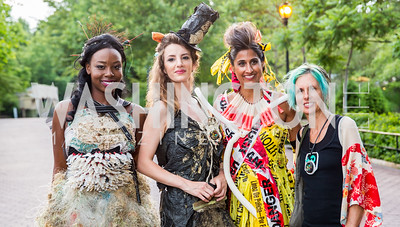 """Trashion"" Models: Chrislene Bright, Nerea Fuentes, Sonia Walia and ""Trashion"" designer Marina DeBris. Photo by Erin Schaff. 2016. Washed Ashore: Art to Save the Sea VIP Reception. Smithsonian National Zoo Elephant Community Center. May 26, 2016."