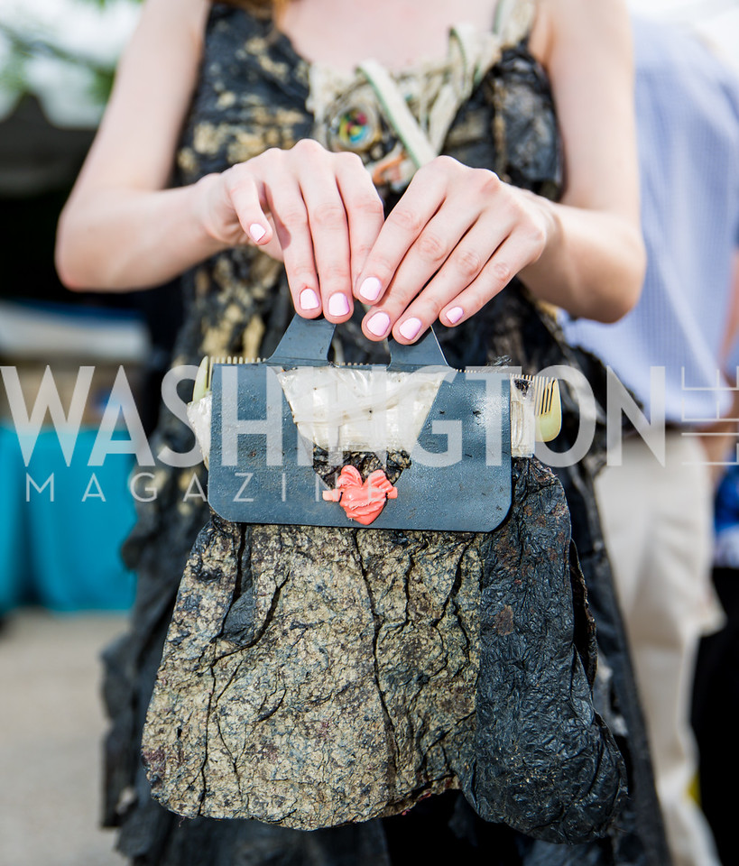 """""""Trashion"""" bag designed by Marina DeBris. Photo by Erin Schaff. 2016. Washed Ashore: Art to Save the Sea VIP Reception. Smithsonian National Zoo Elephant Community Center. May 26, 2016."""