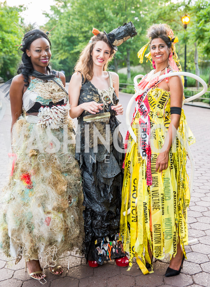 """Trashion"" Models: Chrislene Bright, Nerea Fuentes, Sonia Walia. Photo by Erin Schaff. 2016. Washed Ashore: Art to Save the Sea VIP Reception. Smithsonian National Zoo Elephant Community Center. May 26, 2016."