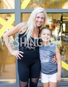 Studio Owner Kelly Wilkinson with her daughter. Photo by Erin Schaff. Xtend Barre Arlington Launch Party. Xtend Barre Arlington. September 10, 2016.