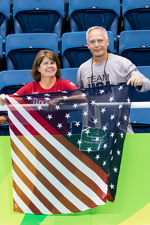 Maria & Mark Meyers, parents of Becca Meyers, pose for a picture before their daughters 400 M SM13 race.  Photo:  Ken King