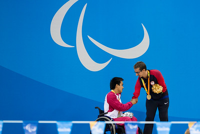 Gold Medalist, Roy Perkins, congratulating Shiwei He (China) silver medalist in the Men's 200 Meter Butterfy.