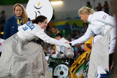 Deluca (USA) conceding to  Krajnyak (HUN) at the end of their match in wheelchair fencing.  Photo:  Ken King