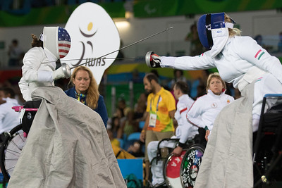 Hungary's Suzsanna Krajnyak makes a move against Lauryn Deluca in wheelchair fencing.  Photo:  Ken King