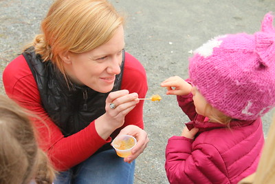 IMG_1913 PJ Eames gives her daughter Hannah,1, a taste