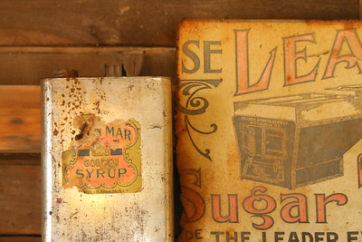 IMG_2430 antique stuff in sugarhouse, a can and ad for an arch