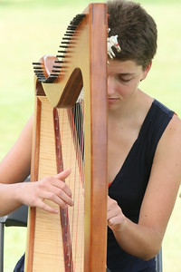 IMG_5779 Louli Zeichner of the Zeichner Trio,,of northfield, plays The Dawn Of Day on harp