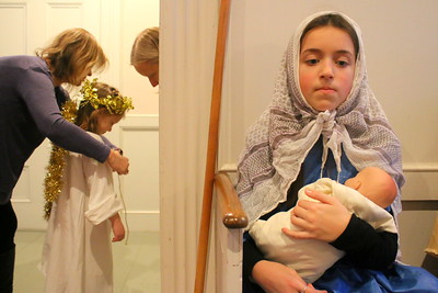 IMG_0115 claudia shoemaker,11, as Mary, sits waiting as angel zella little gets into costume with help of michelle fields