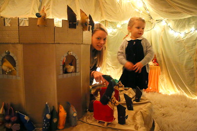 IMG_7935 audrey micca and her daughter chloe,3, in the gnome house,,,there were several diorams set up, kids tried to guess the story each represented