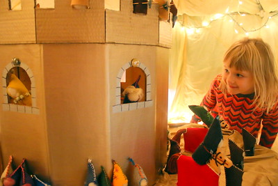 IMG_7958 evie thom,5, looks at display for St George and the Dragon, in the gnome house