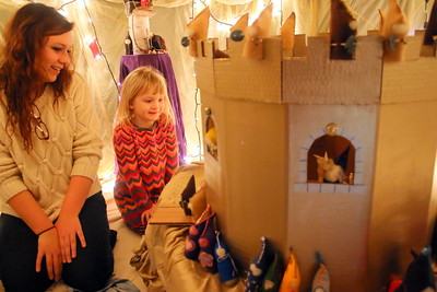 IMG_7962 caregiver laura vogell and evie thom,5, look at the set for St Geroge and the Dragon, in the gnome house