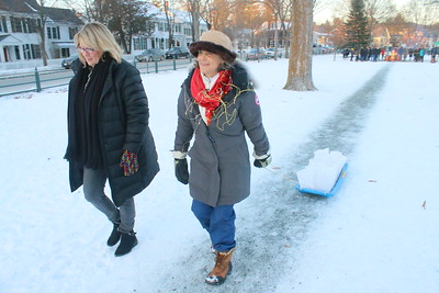 IMG_9535 kristen lessard and candice coburn pull a sled of luminaries to end of the green