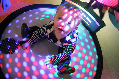 IMG_9370 - Lennon Kramer, 1 of Burlington sits on an exhibit using filter to color light