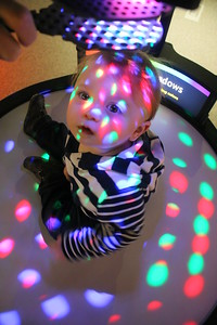 IMG_9410- Lennon Kramer, 1 of Burlington sits on an exhibit using filter to color light