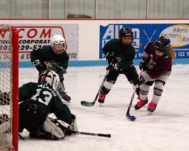 Mites, Dominic Palazzo tends goal while defenders Pavel Milone and Fiona Piconi work hard in the recent Barre Jamboree