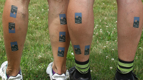 PHOTO BY HERB SWANSON: Riders show their rub on tatoos at the finish line after riding 100 mile from Manchester, NH to Hanover, NH during the the first day of the Prouty in Hanover, New Hampshire on July 7, 2016. The Ultimate Prouty riders also pedaled 100 miles on Saturday July 8, 2016 during day two of the Prouty.