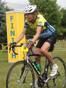 PHOTO BY HERB SWANSON: Julia Burdick crosses the finish line after riding  100 mile from Manchester, NH to Hanover, NH during the the first day of the Prouty in Hanover, New Hampshire on July 7, 2016. The rider also pedaled 100 miles on Saturday July 8, 2016 during day two of the Prouty.