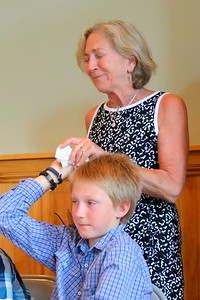 IMG_4094 max hambsch hands principal anne koop a tissue as she shed a few tears while speaking about each student