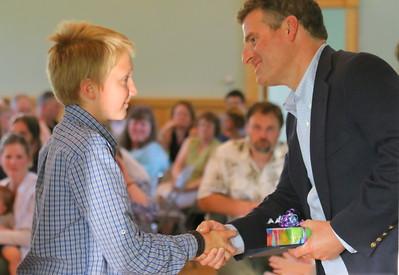 IMG_4141  Max hambsch gets diploma from chip davis, chairman of barnard school board