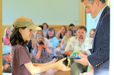 IMG_4144 godon twigg-smith gets diploma from chip davis, chair of barndard school board