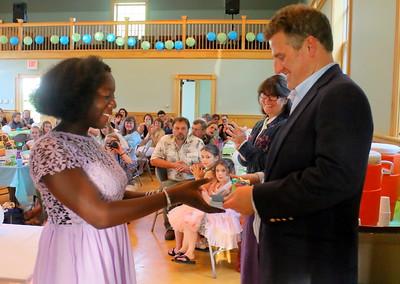 IMG_4151 zoe wood gets diploma from chip davis, chairman of the barnard school board