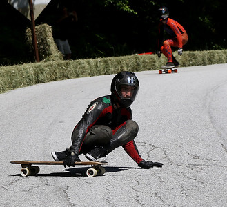 Boarders and lugers compete in Downhill Throwdown.