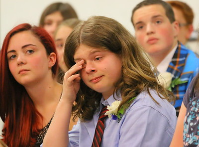 IMG_6079 Colin Mangan wipes off a tear as he listens to classmate Belle Moulton give a speech about the lolalty between a boy and a dog-001
