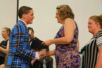IMG_6184 brayton bailey gets diploma from school board chair Bettina Read