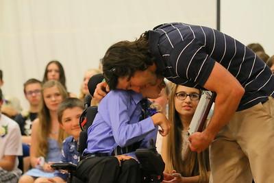 IMG_6143 BEST ,, Joshua  Willens gets hug from PE teacher Pete Driscoll after getting the Zoe Richardson Memorial award