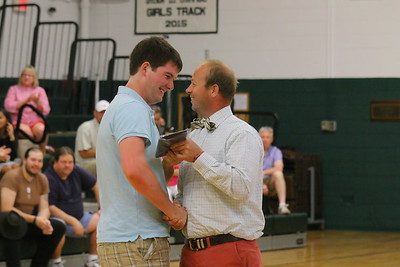 IMG_2580 Gordon MacMaster gets the We Are Selfless award from coach brandon little