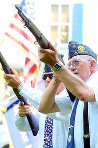 IMG_1734 Denny Hewitt and Jim Ford, of the rifle squad, fire a salute at the legion hall location