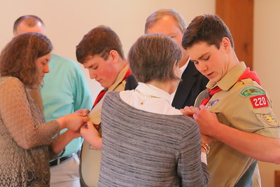 IMG_8653 leanne chynowtih pins Eagle on her son tyler at left  cathy bollinger pins Eagle on her son Charlie at right  moms pinned on the Eagle, dads put on the eagle rank neckerchief