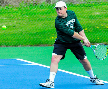 Playing at No  2 singles, senior Bryan Kopf returns a backhand against Rutland - Tim Gould
