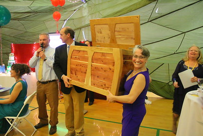 IMG_7371 autioneer and teacher andrew lane, with help of brad atwood and jenn hayslett, during aution, with a custom chest made by mike hillinger, the former chair of TSA board