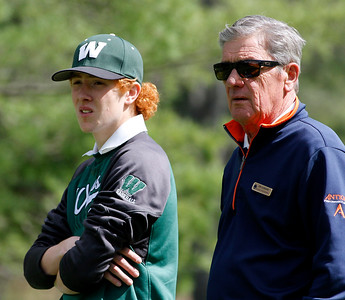 Photo by Herb Swanson:      Joe Bianchi with the team coach  Jim Gunnare  on the first tee during a match at the Woodstock Country Club in Woodstock, Vermont on Tuesday May 17, 2016.