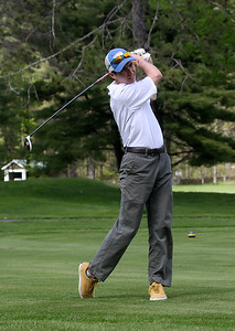 Photo by Herb Swanson:      Andrew Borden shoots from the fairway during a match at the Woodstock Country Club in Woodstock, Vermont on Tuesday May 17, 2016.